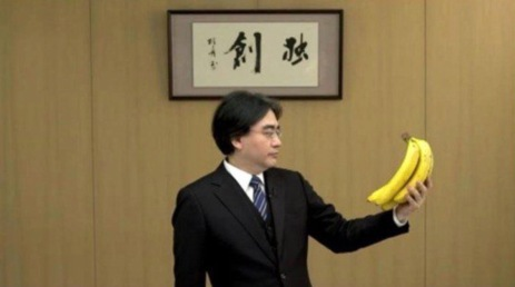 Iwata holds a bunch of bananas during a Nintendo Direct.
