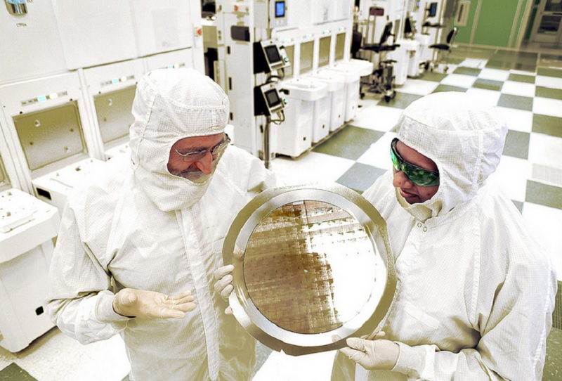 IBM technicians hold wafer with 7-nanometer chips.