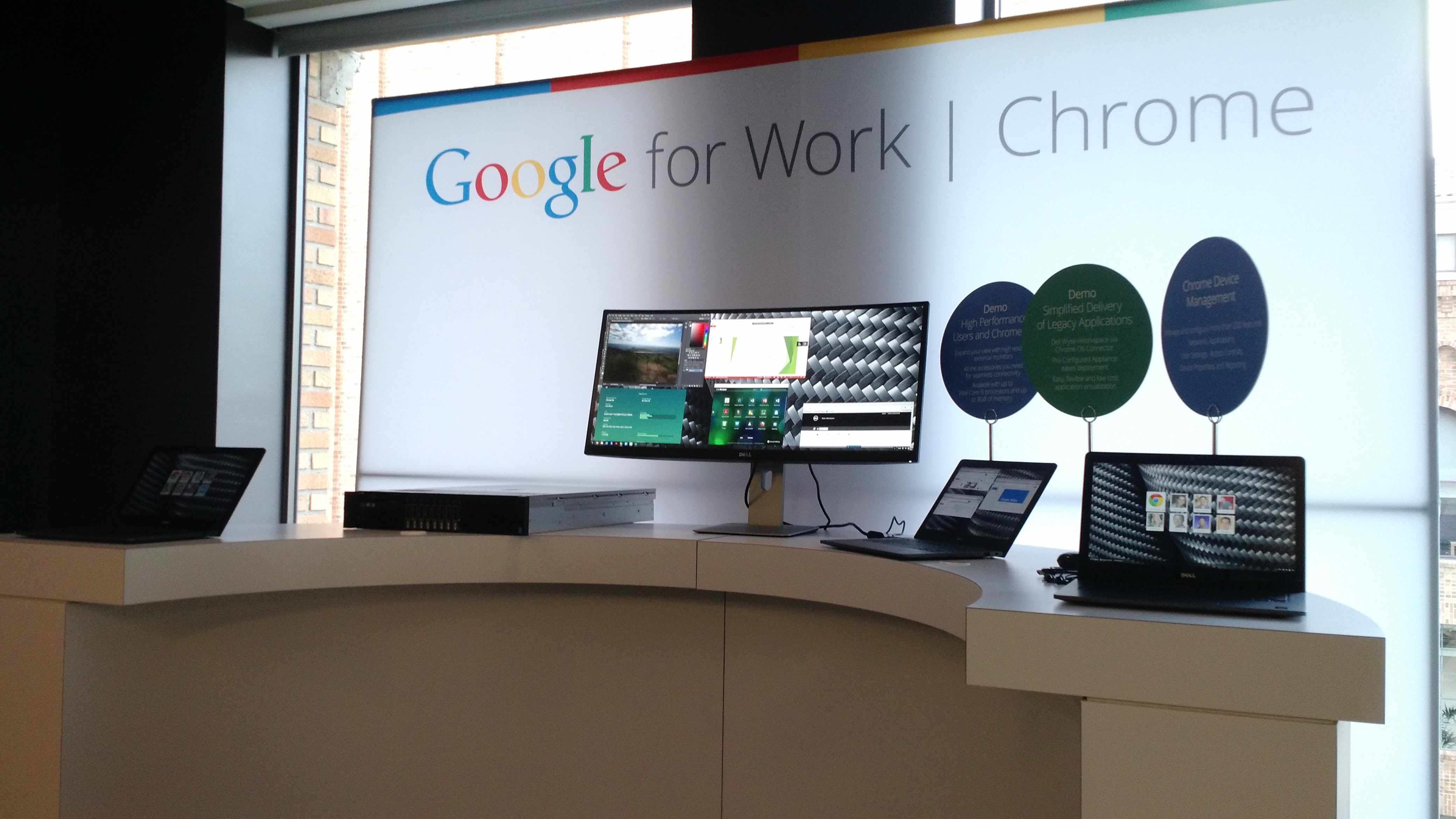 Chromebooks for Work. The big screen in the middle is running Microsoft Word and Adobe Photoshop.