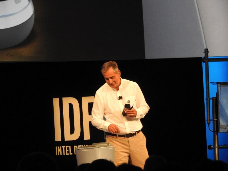 Robot brings a soda to Brian Krzanich, CEO of Intel.