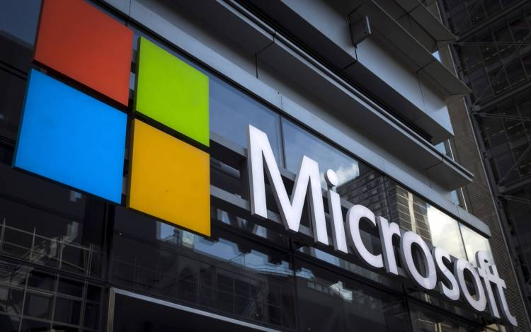 A Microsoft logo is seen on an office building in New York City, July 28, 2015.