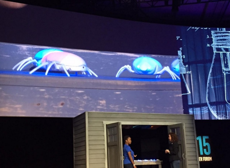 Sade shows off an electronic scarab beetle to Intel's Genevieve Bell.