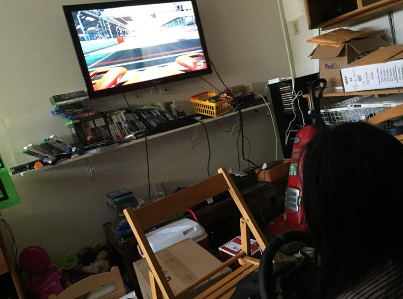 My kid, driving with the Logitech G29 Driving Force racing wheel.