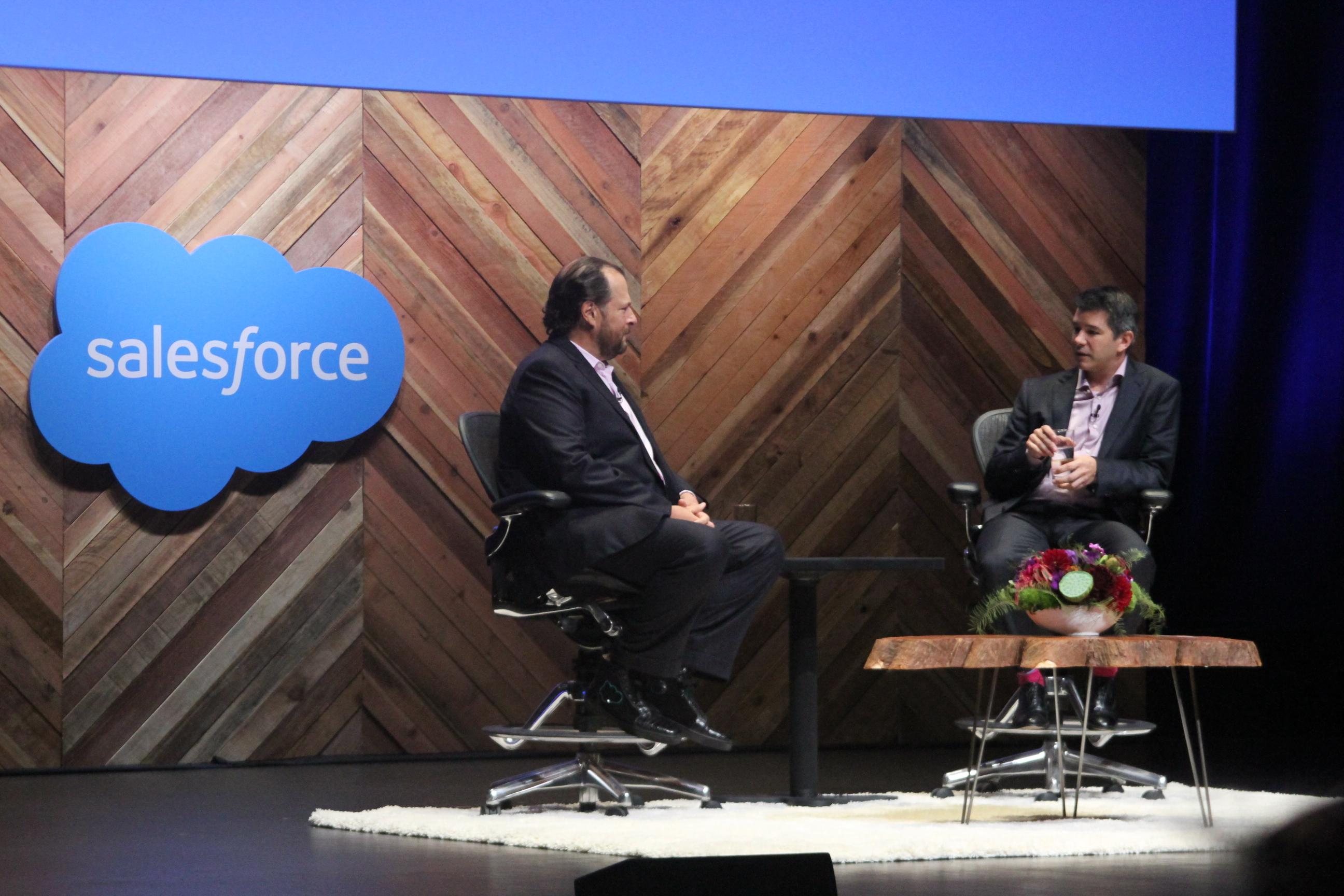 Salesforce CEO Marc Benioff and Uber CEO Travis Kalanick on stage during a fireside chat at Dreamforce 2015.
