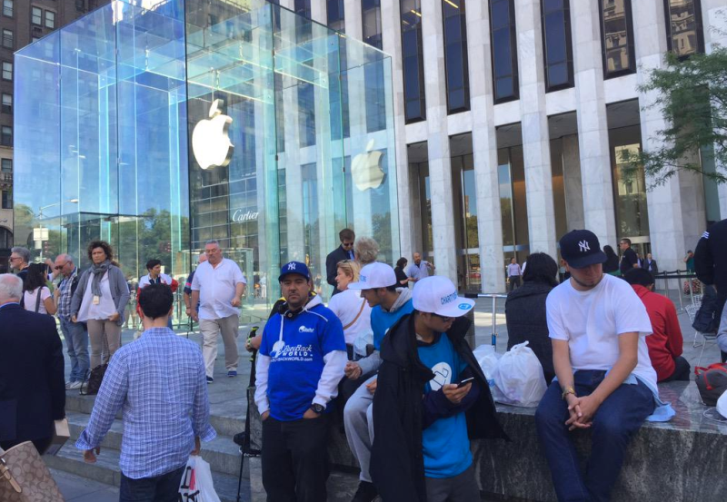 "Apple fans line up at the ""Church of Apple"" in New York to buy an iPhone 6s Friday."