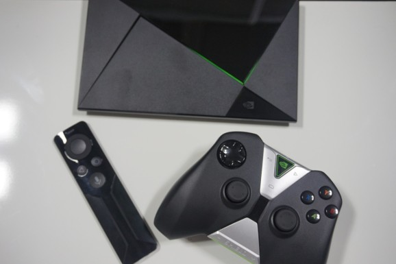 The Nvidia Shield microconsole with remote and gamepad.