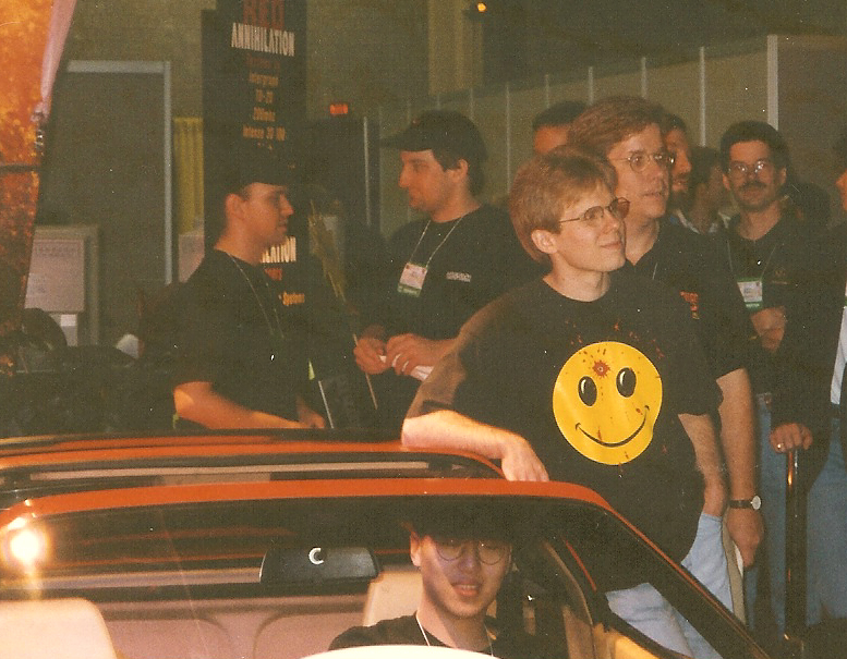 "Dennis ""Thresh"" Fong in the Ferrari 328GTS convertible he won in the Red Annihilation Quake Tournament at the 1997 Electronic Entertainment Expo (E3)."