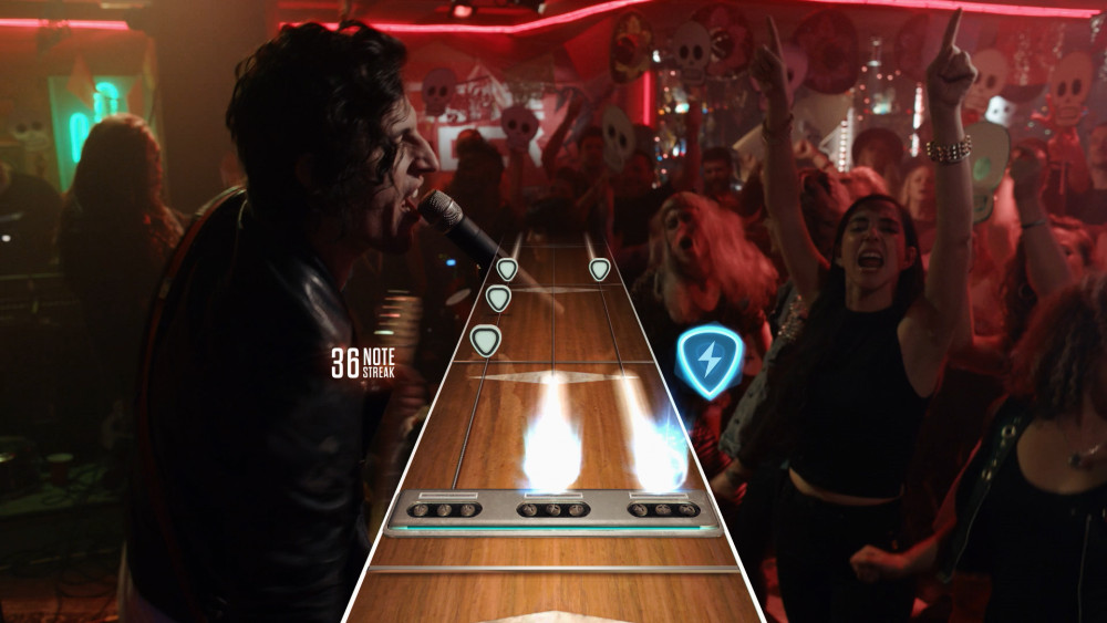"""The """"Live"""" portion uses live-action shots to have you play at expansive and intimate venues."""