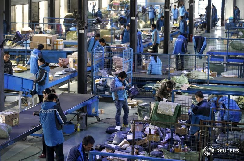 Employees work at a sorting centre of Zhongtong (ZTO) Express ahead of the Singles Day shopping festival, Chaoyang District, Beijing, November 8, 2015.