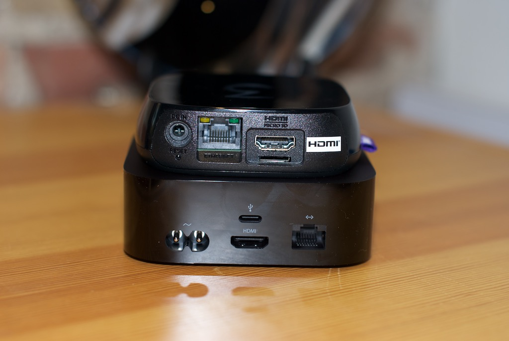 Roku 3 (above) and Apple TV 4th gen (below): Apple's remote may be the thinnest of them all, but its black box seems to have gained some pounds. Photo by Simon Cohen.