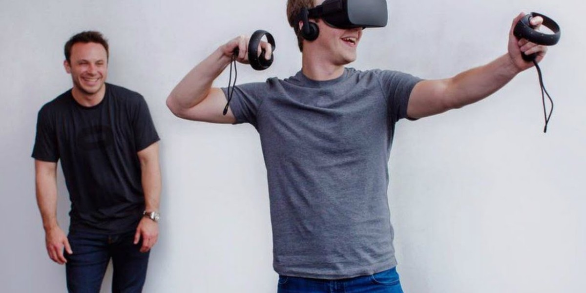 Mark Zuckerberg, Facebook CEO, in the Oculus Rift virtual reality headset as then-Oculus VR CEO Brendan Iribe looks on, in 2015.