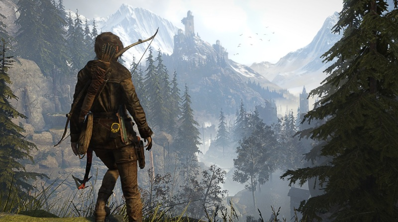 Lara Croft looks across a valley toward a distant goal in Rise of the Tomb Raider.