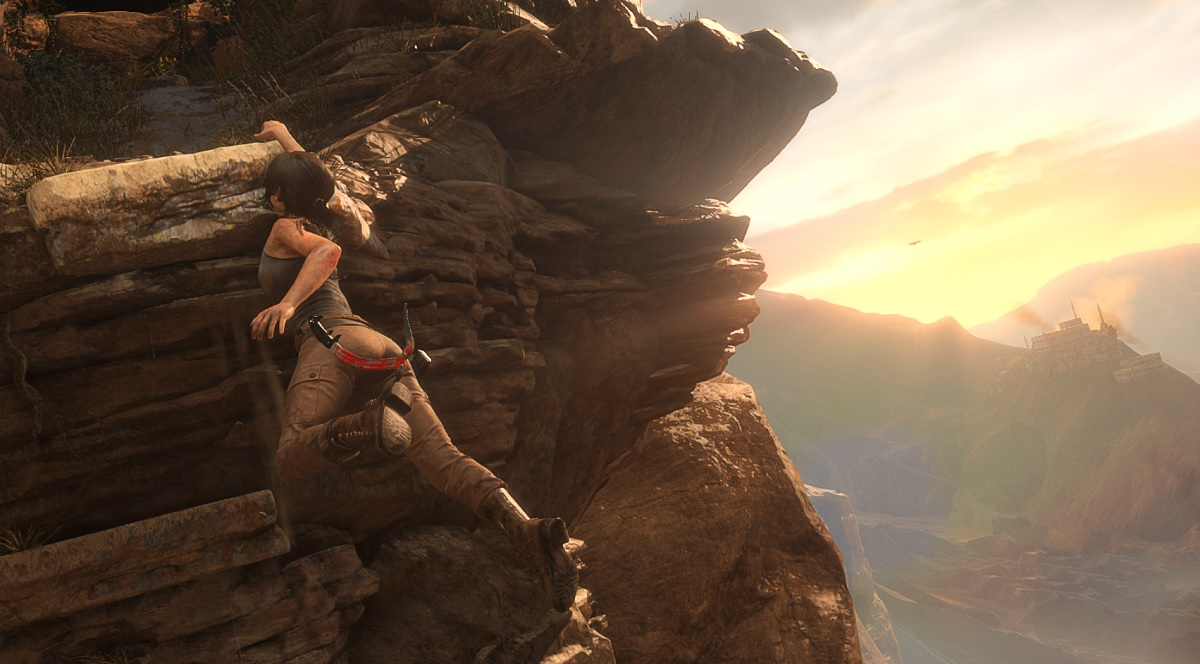 Lara Croft scales a cliff in Syria in Rise of the Tomb Raider.