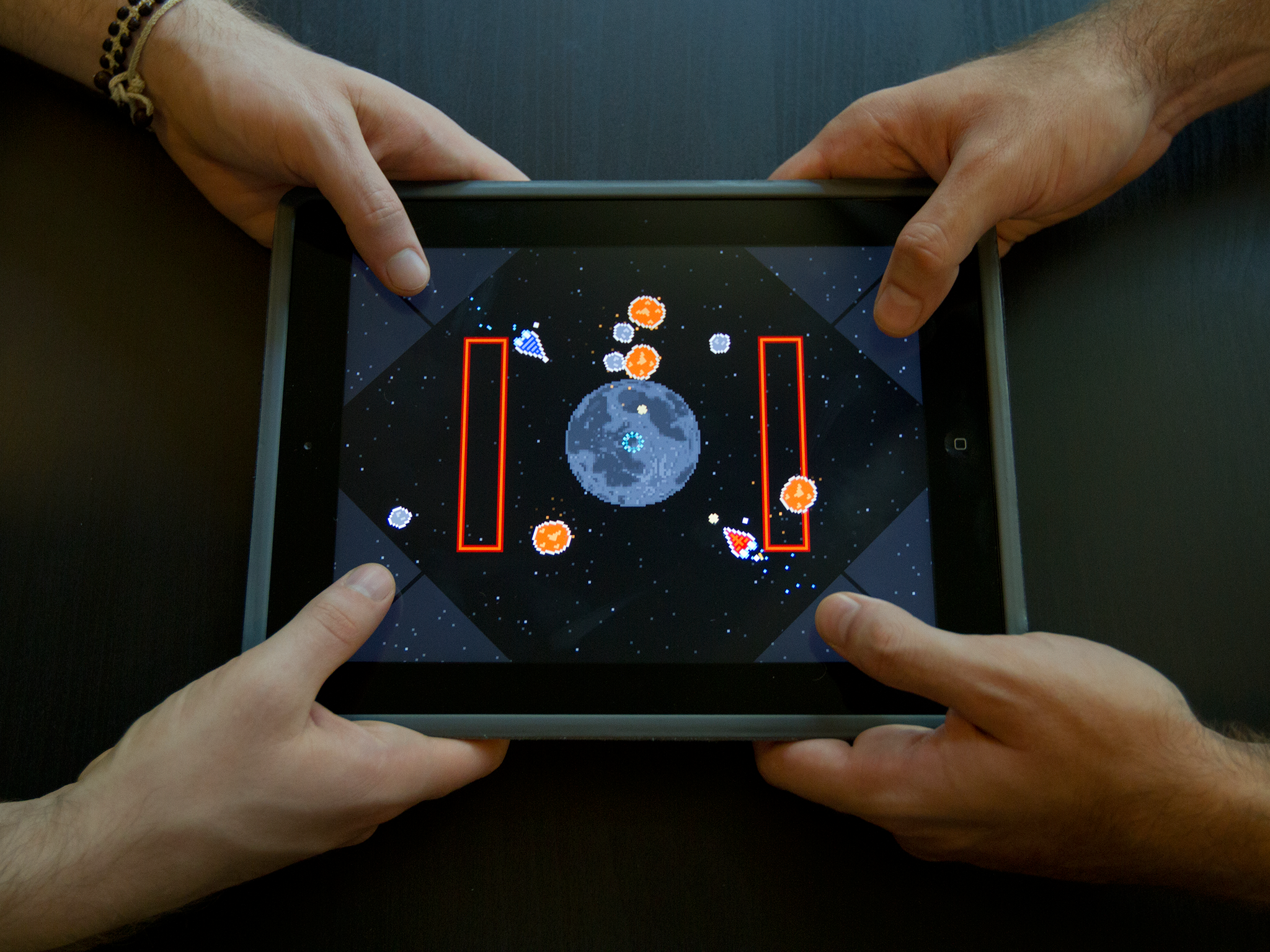 Two players battle it out on Astro Duel for iPad.