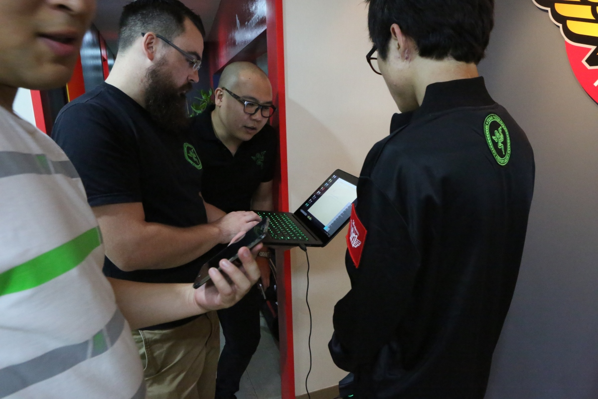 Drew Holt-Kentwell (with laptop) configures a Razer Synapse for an event.