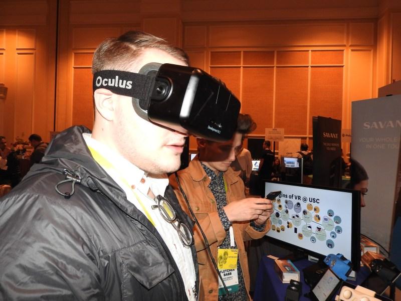 Harrison Weber of VentureBeat tries out an Oculus Rift.
