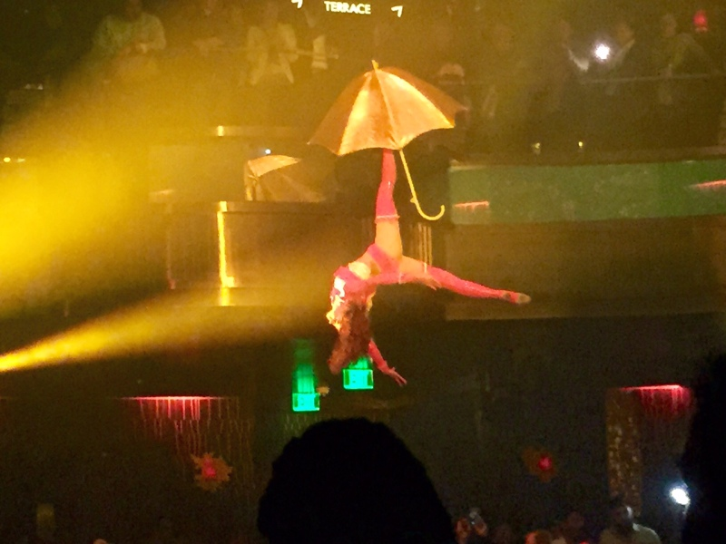 A woman hangs from the ceiling at the Omnia nightclub.