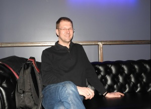 Hannes Seifert is smiling but I'm about to assassinate him with my questions.