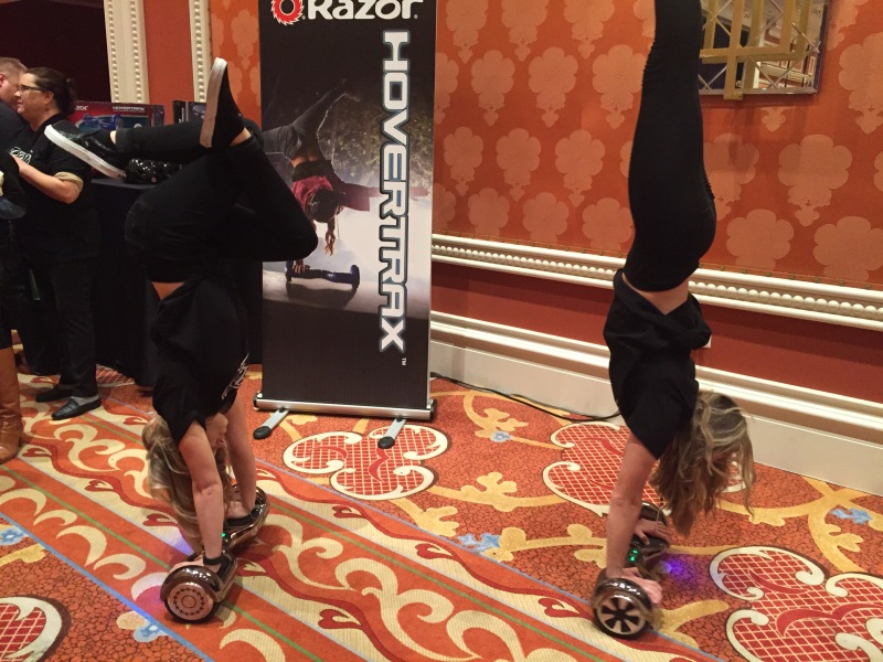 Models show off the Razor Hovertrax at CES 2016