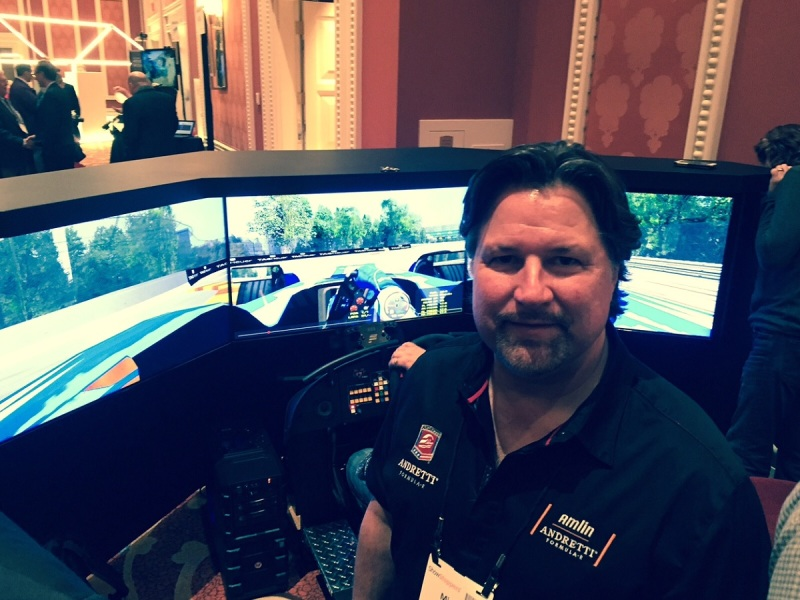 Michael Andretti of Amlin Andretti Formula E team, in front of a racing simulator at CES 2016.