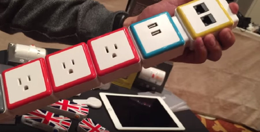 Stack from OneAdaptr lets you snap together parts of a surge protector.