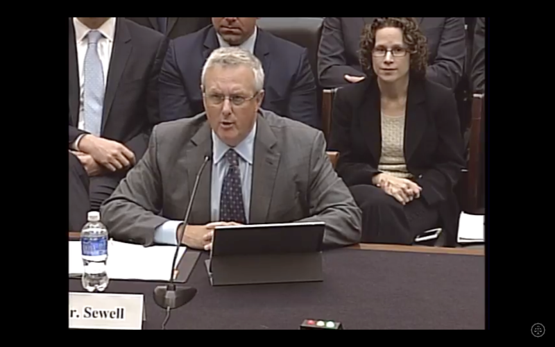 Apple general counsel and senior vice president Bruce Sewell speaks at a House Judiciary Committee hearing in Washington on March 1, 2016.