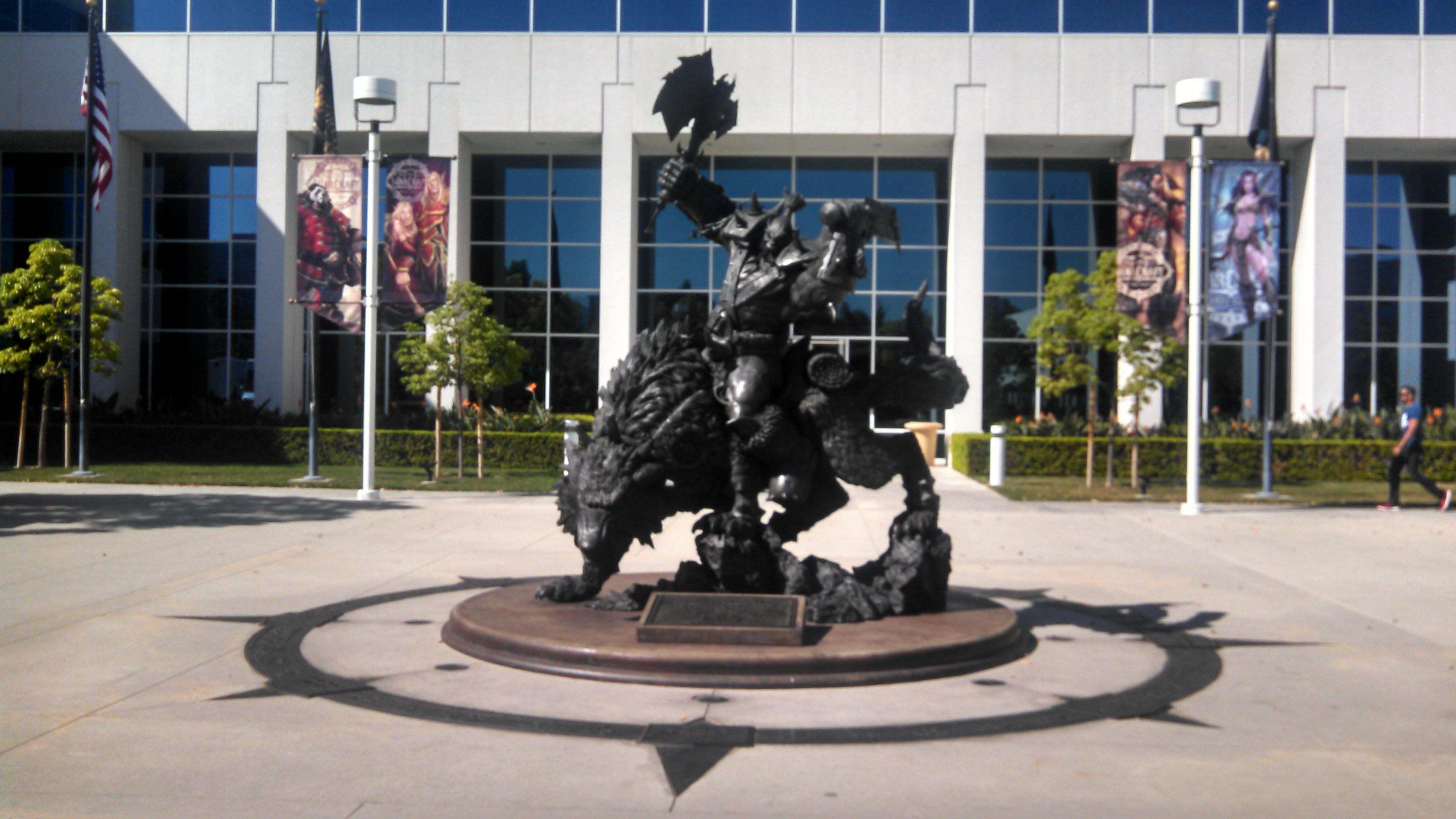 An orc rider guards the door at BlizzCon headquarters, surrounded by a compass rose of the company's core values.