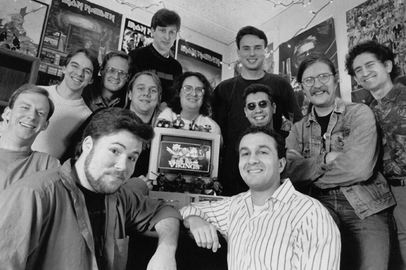 The early Blizzard team (then known as Silicon & Synapse), with Allen Adham in the striped shirt and Mike Morhaime on the far right.