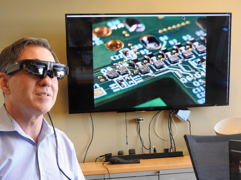 Jim Marggraff, CEO of Eyefluence, wearing AR glasses with Eyefluence prototype hardware attached.
