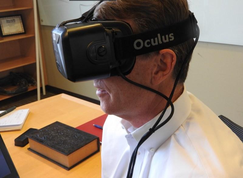Eyefluence CEO Jim Marggraff wears an Oculus Rift VR headset.