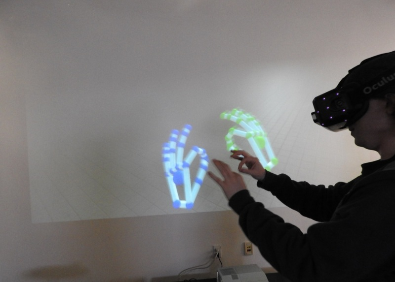 You can grab things with two fingers using Leap Motion in virtual reality.