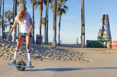 Above Onewheel Has A Motor That Keeps You Balanced As Ride
