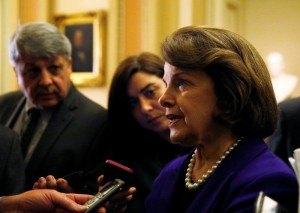 Senate Intelligence Committee chair Senator Dianne Feinstein (D-CA) (R) talks to reporters after coming out of the Senate in Washington December 9, 2014.