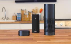 A collection of Amazon devices powered by Alexa. From left to right: Echo Dot, Amazon Tap, and Amazon Echo.
