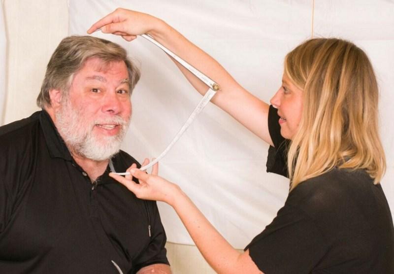Steve Wozniak gets measured for his own wax figure.