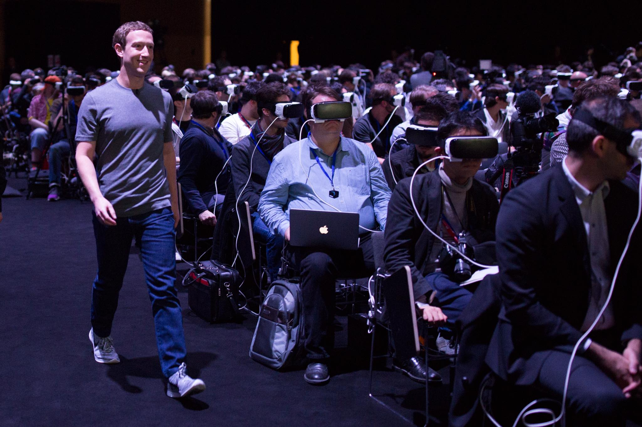 Facebook CEO Mark Zuckerberg walks to the stage during Samsung's press conference at the Mobile World Congress on February 21, 2016. Attendees viewed the presentation wearing Samsung's Gear VR headsets.