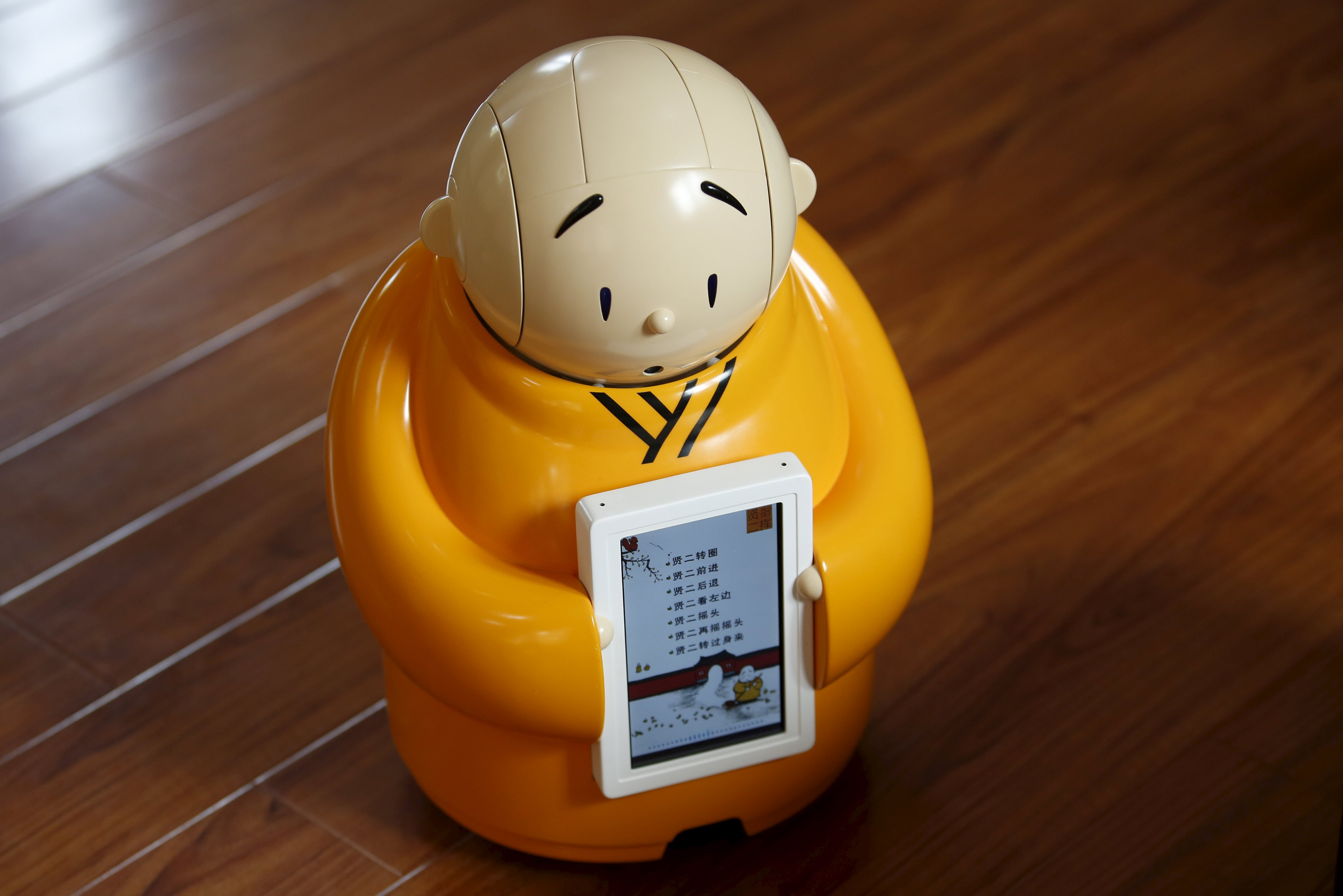 Robot monk Xian'er is pictured during its demonstration for a photo opportunity at Longquan Buddhist temple on the outskirts of Beijing, April 20, 2016. REUTERS/Kim Kyung-Hoon
