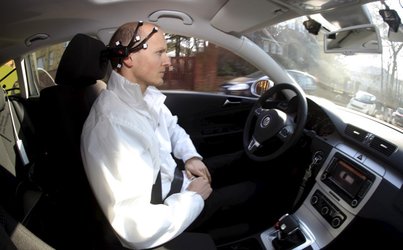 Daniel Goehring, of the AutoNOMOS research team of the Artificial Intelligence Group at the Freie Universitaet (Free University), demonstrates hands-free driving of the research car named 'MadeInGermany' during a test in Berlin, Germany February 28, 2011. REUTERS/Fabrizio Bensch/File Photo
