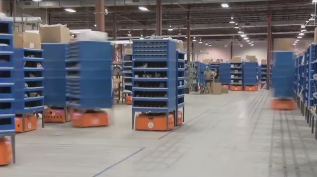 Still shot of Amazon's smart shelves in action from a Kiva Systems YouTube video.