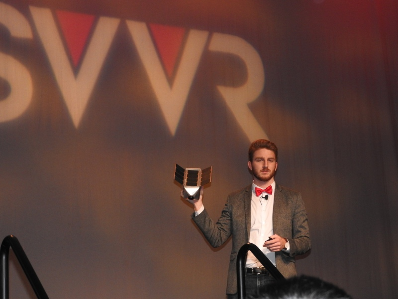 Ben Holmes holds SpaceVR satellite VR camera.
