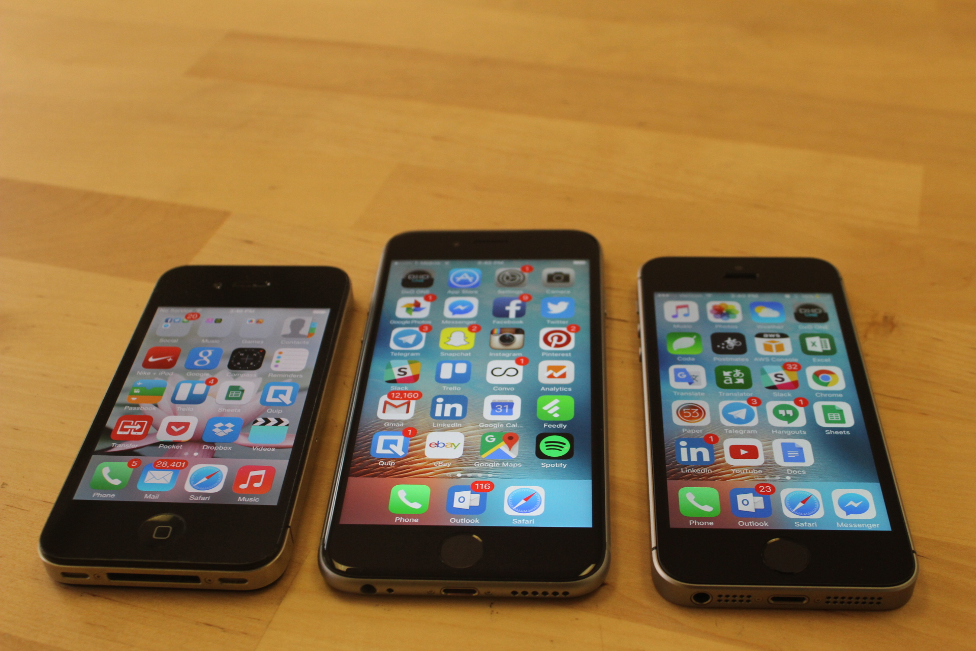 From left, the iPhone 4 from 2010, the iPhone 6s from 2015, and the new iPhone SE.