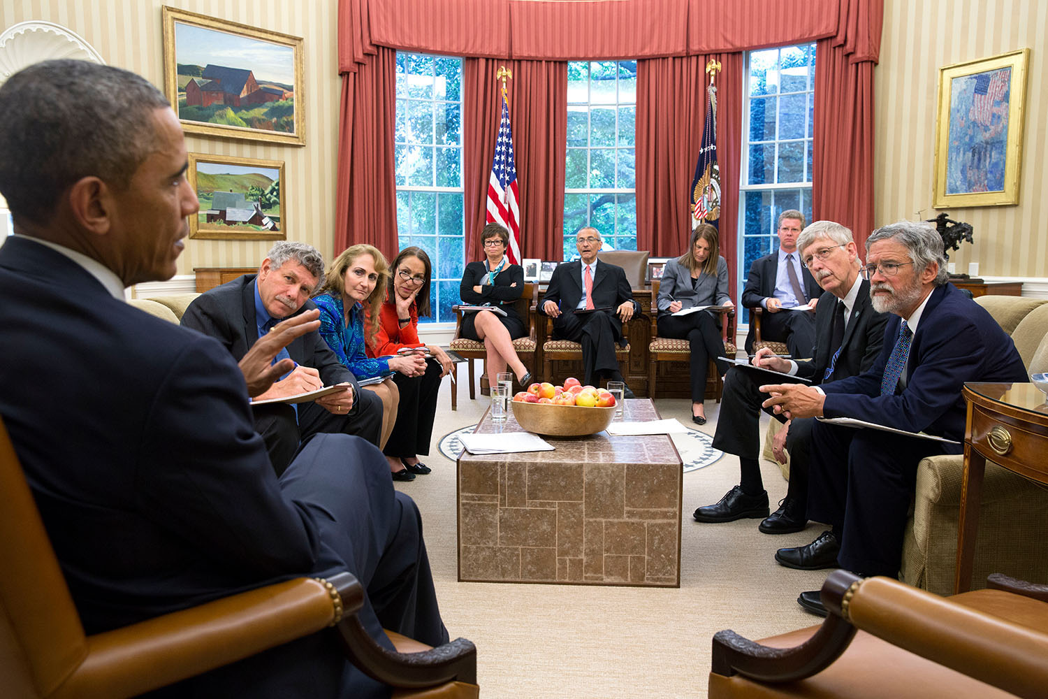 President Barack Obama holds a precision medicine meeting in the Oval Office, Oct. 3, 2014. Seated, from left, are: Eric Lander, Co-Chair, President's Council of Advisors on Science and Technology; Jo Handelsman, Associate Director for Science, Office of Science and Technology Policy; Margaret Hamburg, FDA Commissioner; Senior Advisor Valerie Jarrett; John Podesta, Counselor to the President; Health and Human Services Secretary Sylvia Mathews Burwell; Shaun Donovan, Director, Office of Management and Budget; Francis Collins, Director, National Institutes of Health; and Dr. John Holdren, Director of the Office of Science and Technology Policy. (Official White House Photo by Pete Souza) This official White House photograph is being made available only for publication by news organizations and/or for personal use printing by the subject(s) of the photograph. The photograph may not be manipulated in any way and may not be used in commercial or political materials, advertisements, emails, products, promotions that in any way suggests approval or endorsement of the President, the First Family, or the White House.