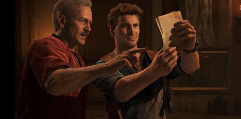 Sully and Nathan Drake share a moment of discovery in Uncharted 4: A Thief's End.