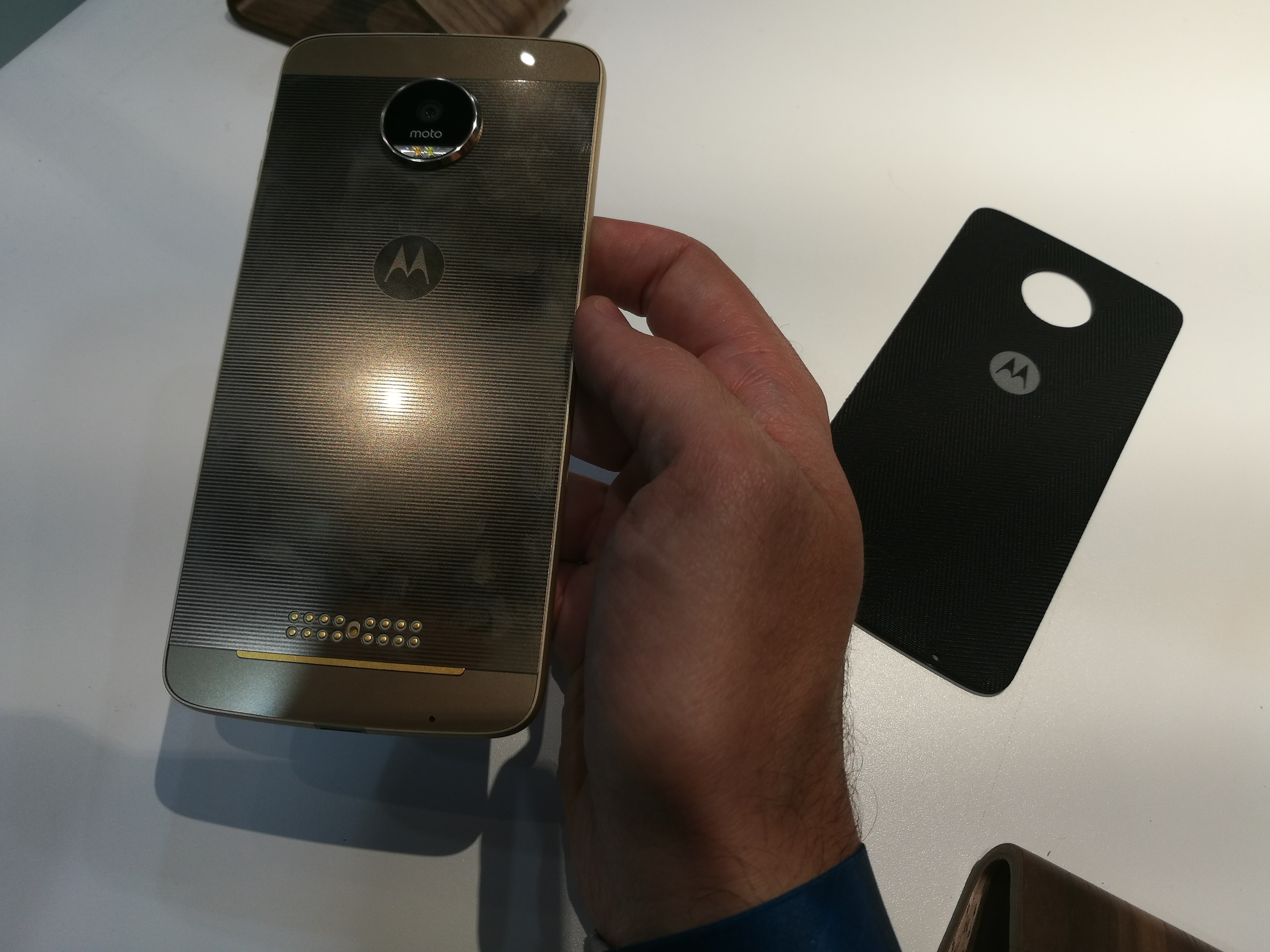 Lenovo's Moto Z, and an attachable backing on the right.