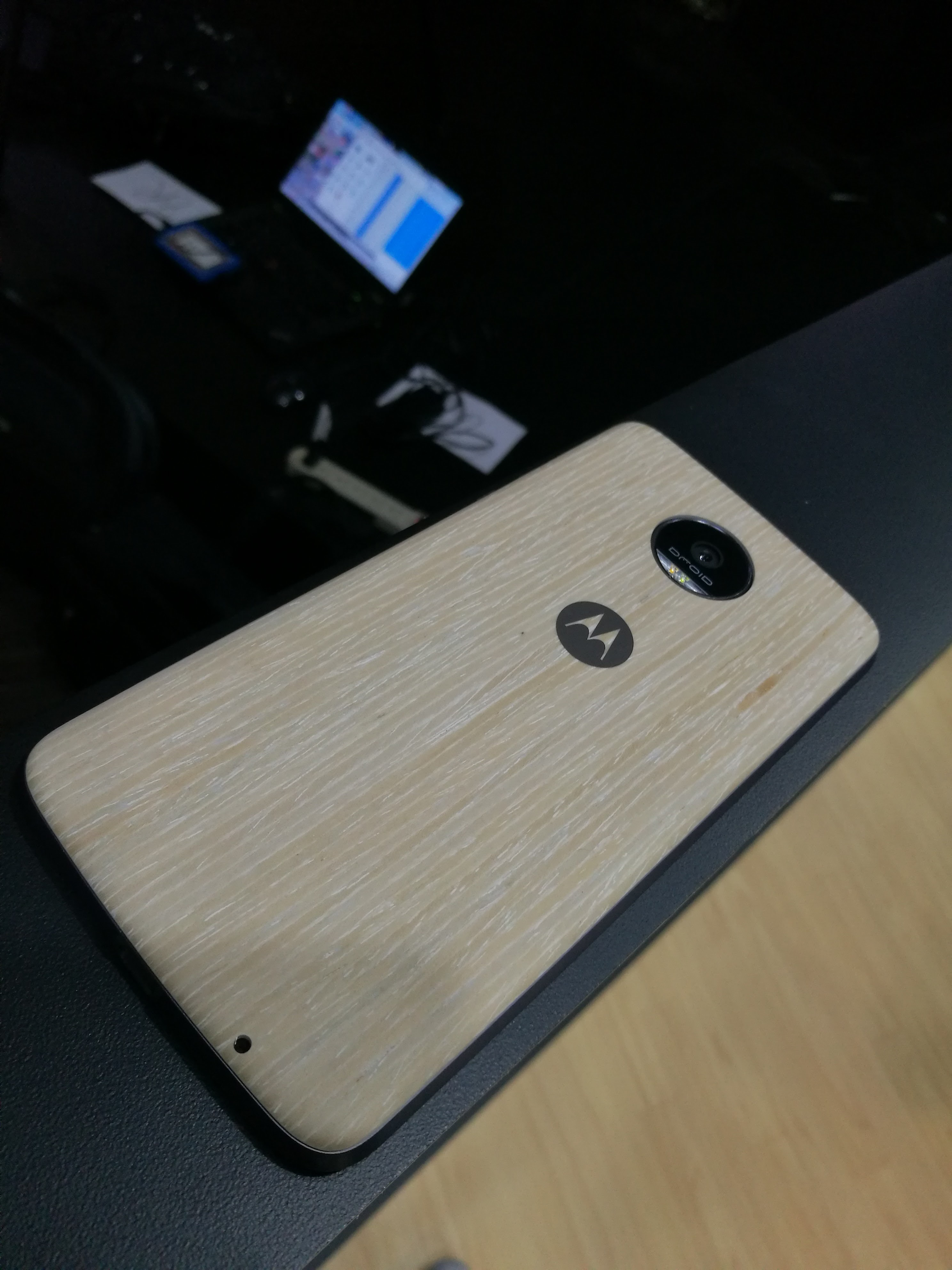 The Moto Z Force with a case on it.
