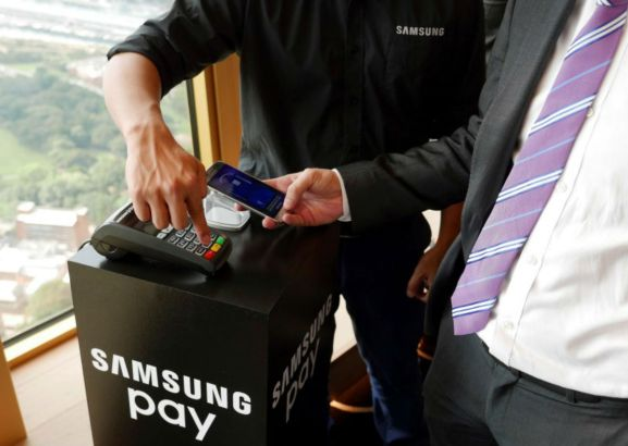 This photo shows Samsung's new Samsung Pay mobile wallet system is demonstrated at its Australian launch in Sydney, June 15, 2016.