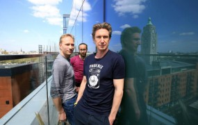 This is a photo of Russian co-founders of Sweatcoin fitness app (L-R) Oleg Fomenko, Ranbir Arora and Anton Derlyatka pose for a photograph at their office in London, Britain May 4, 2016.