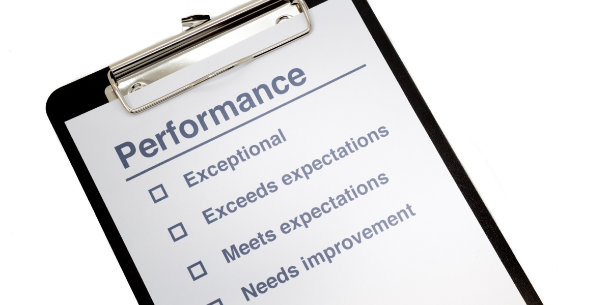 A clipboard holding a Performance Evaluation worksheet