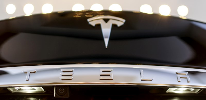 A Tesla logo adorns a 'Model S' car in the dealership in Berlin, Germany, November 18, 2015.