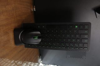 The keyboard and mouse on the charging dock.
